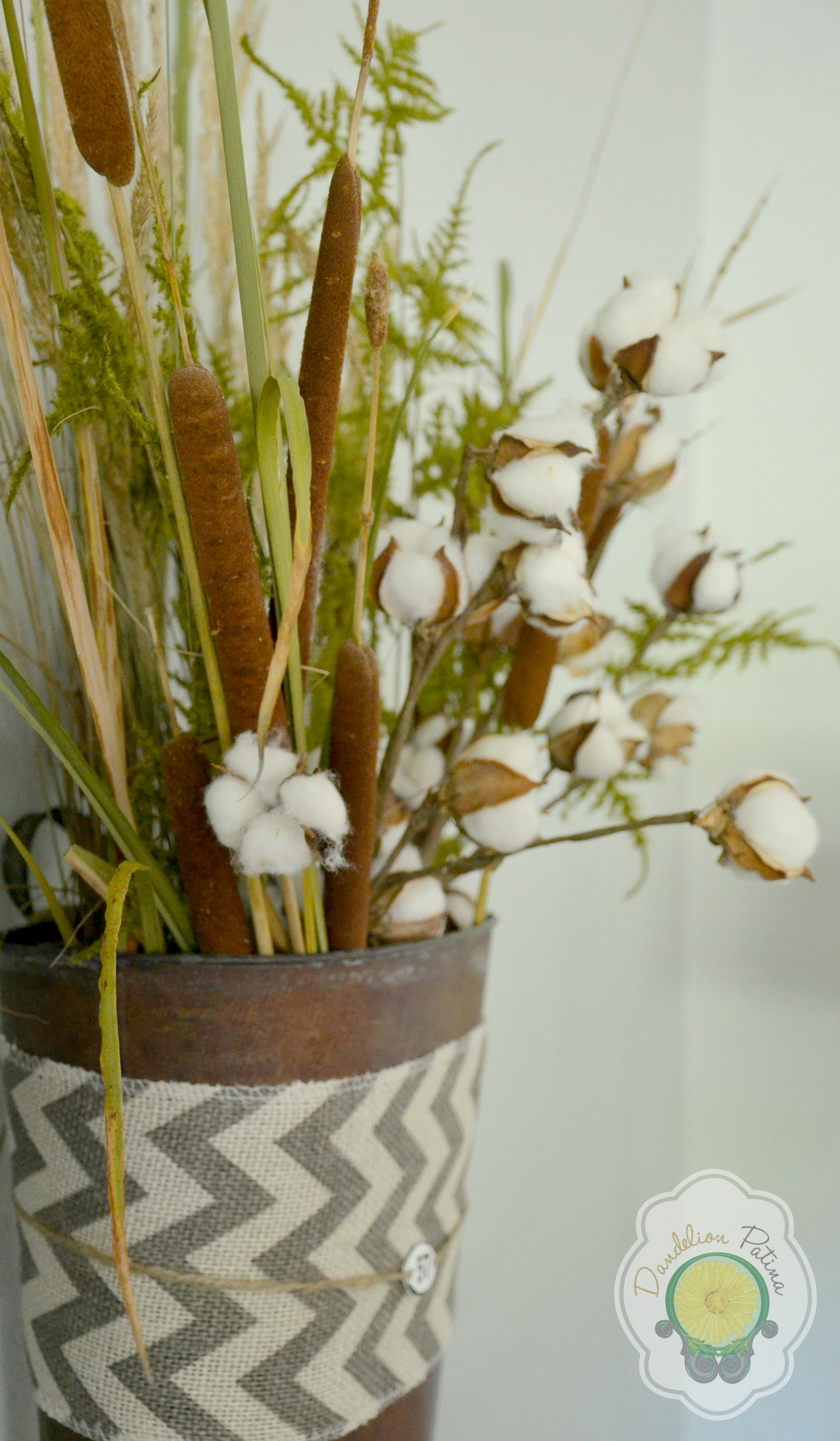 rusty buckets with cattails, cotton boll and ferns