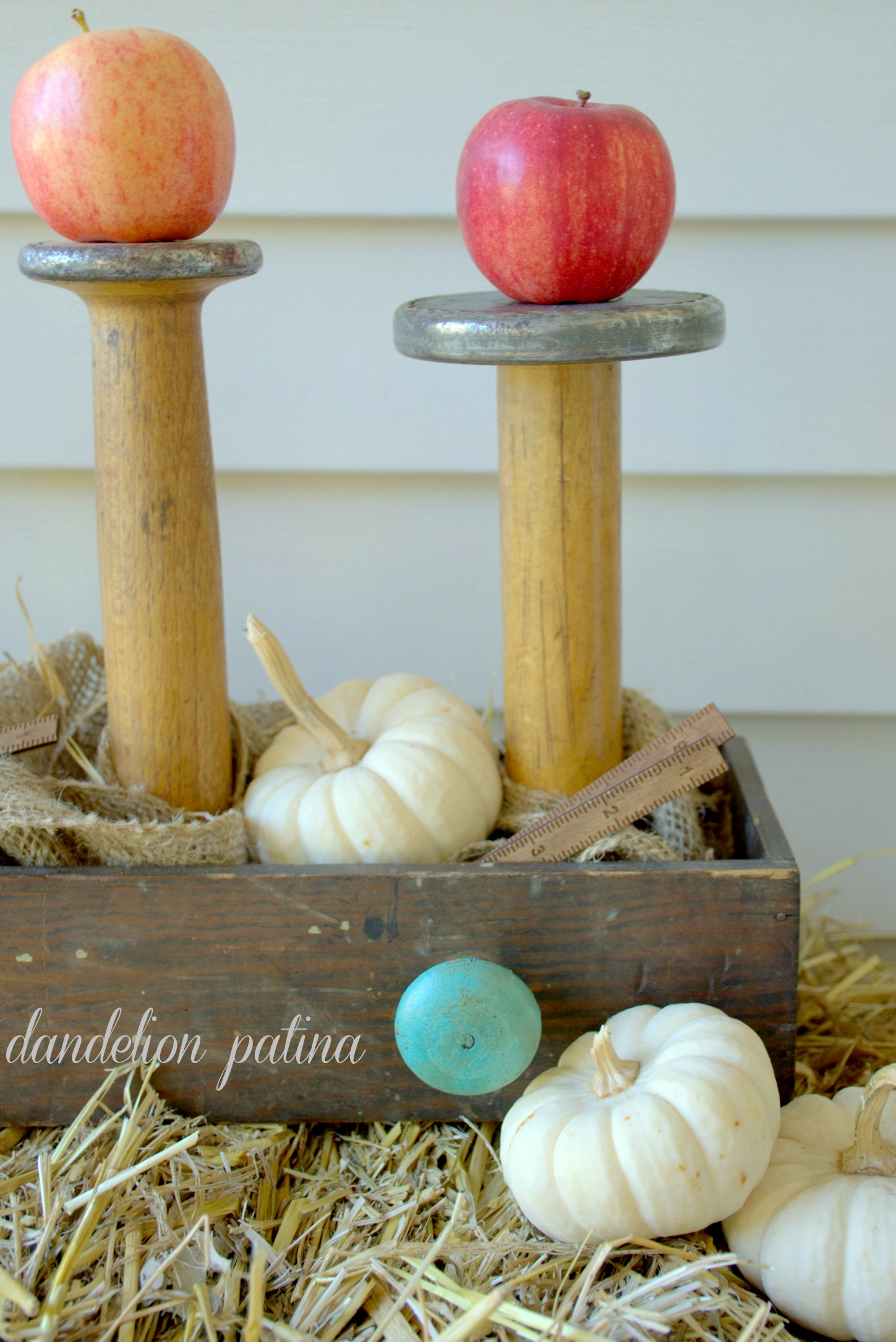 apples on vintage wooden spools
