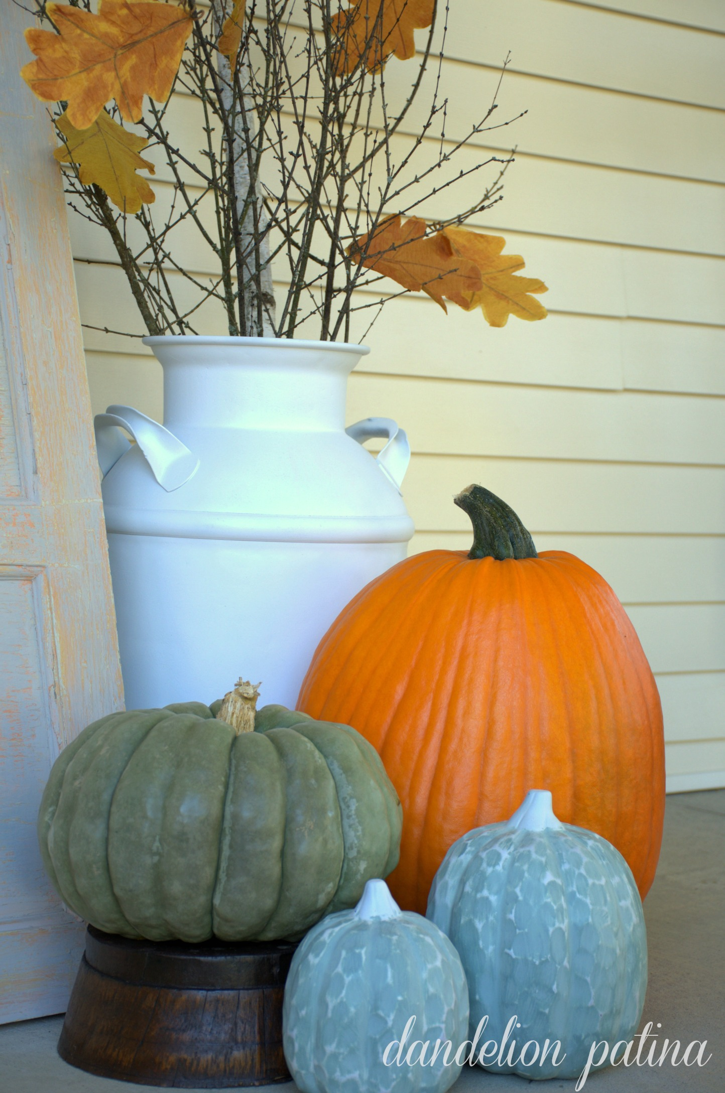 fall vignette in comforts of home fall front porch