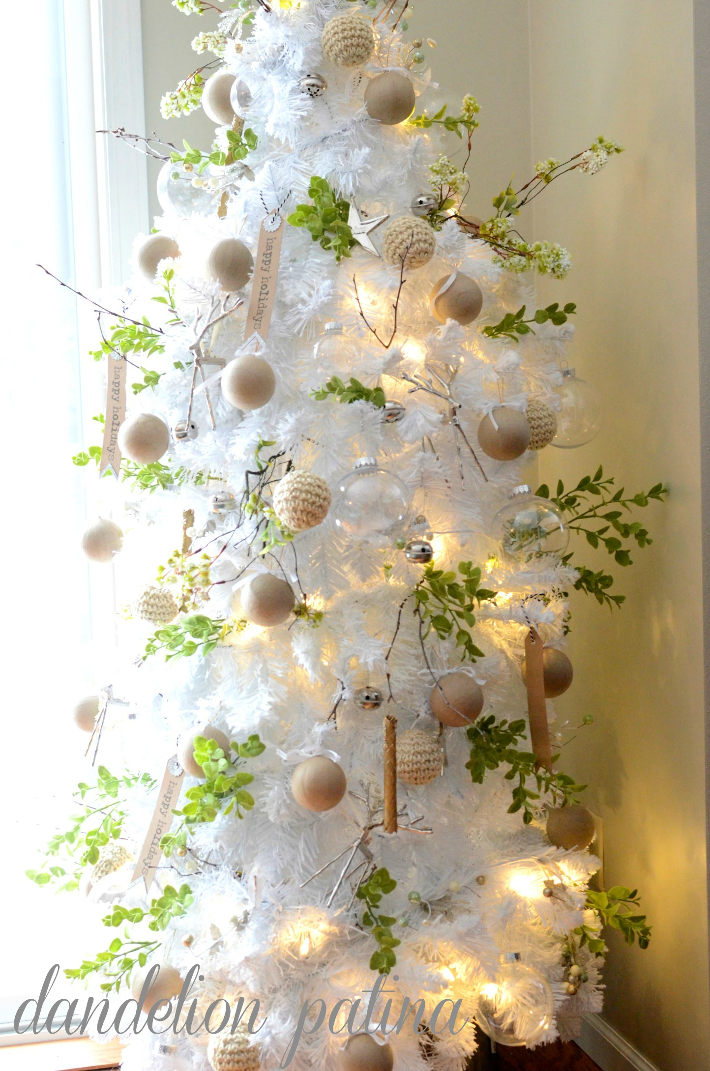 white flocked tree made with garland