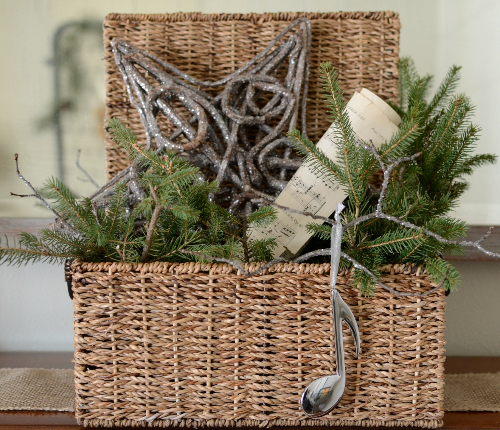 music basket with holiday greens
