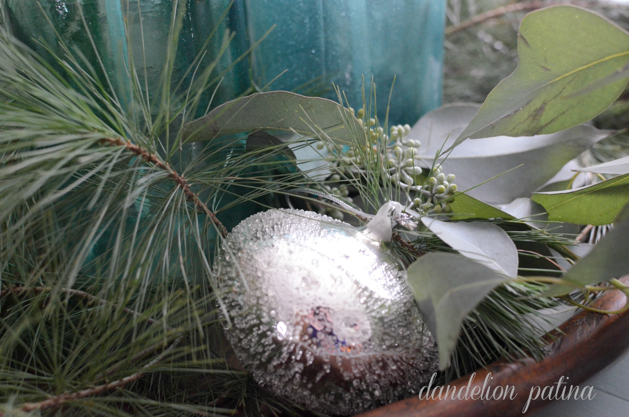 silver ornament with seeded eucalyptus
