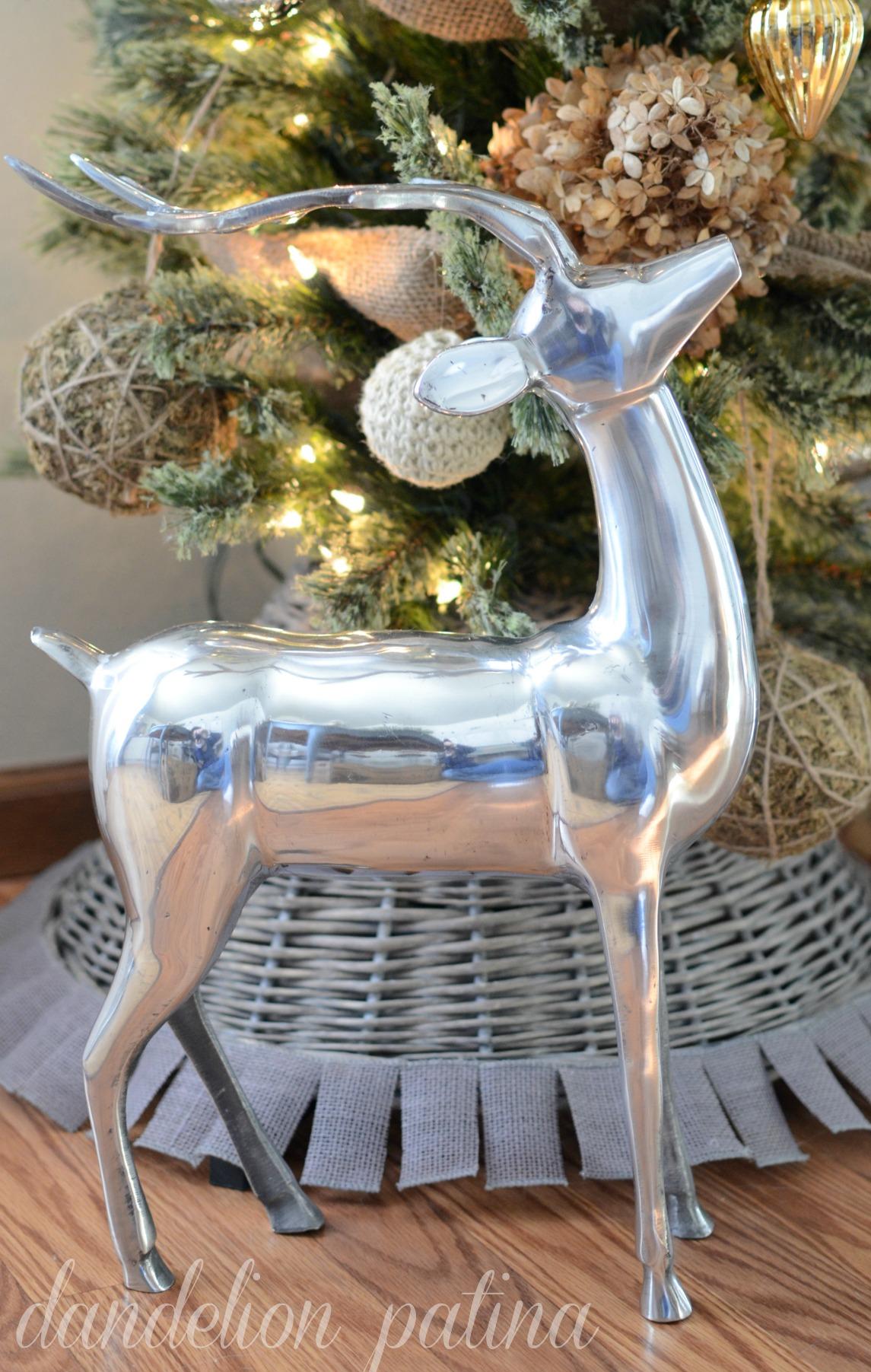 silver metal statue of reindeer