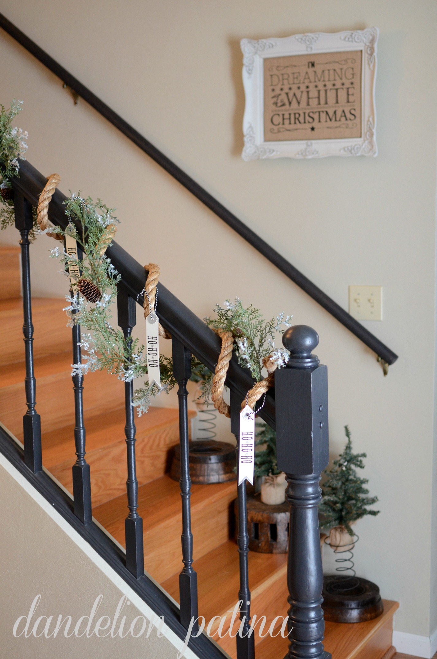 black banister with garland