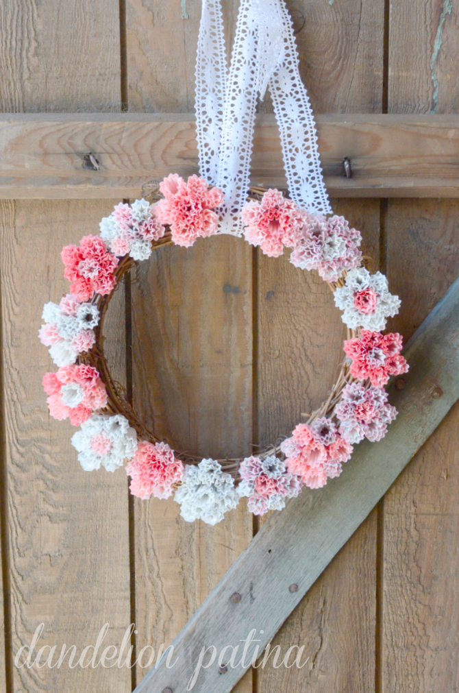 wreath with cupcake liner flowers