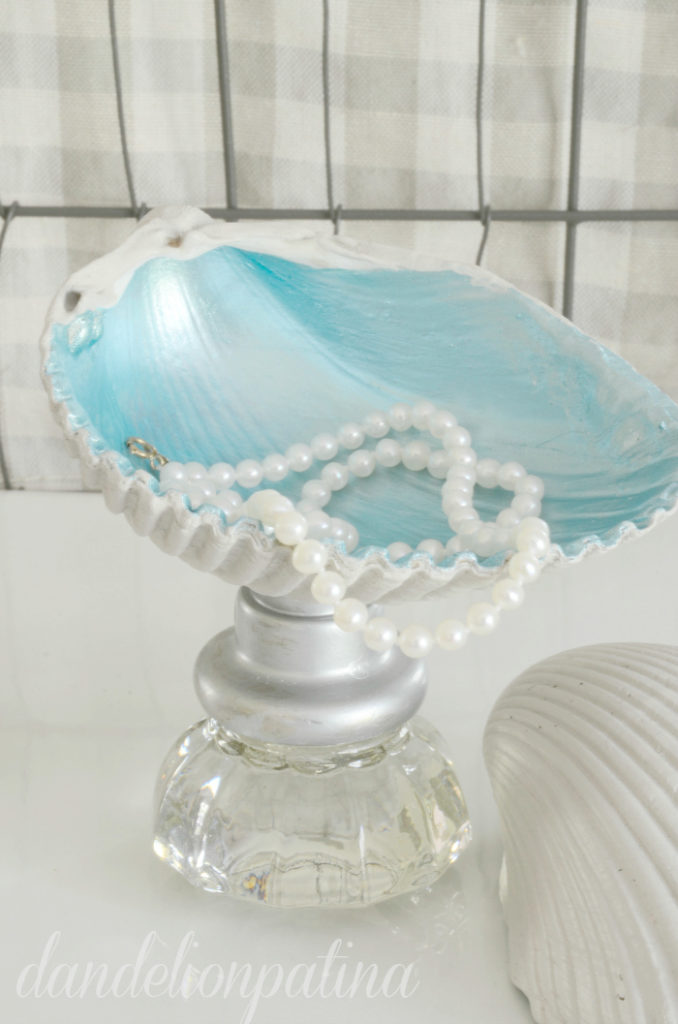 Create your own coastal inspired jewelry bowls with some treasures from the beach and a few vintage glass knobs. You will love these placed in a tray to keep all your treasures in.