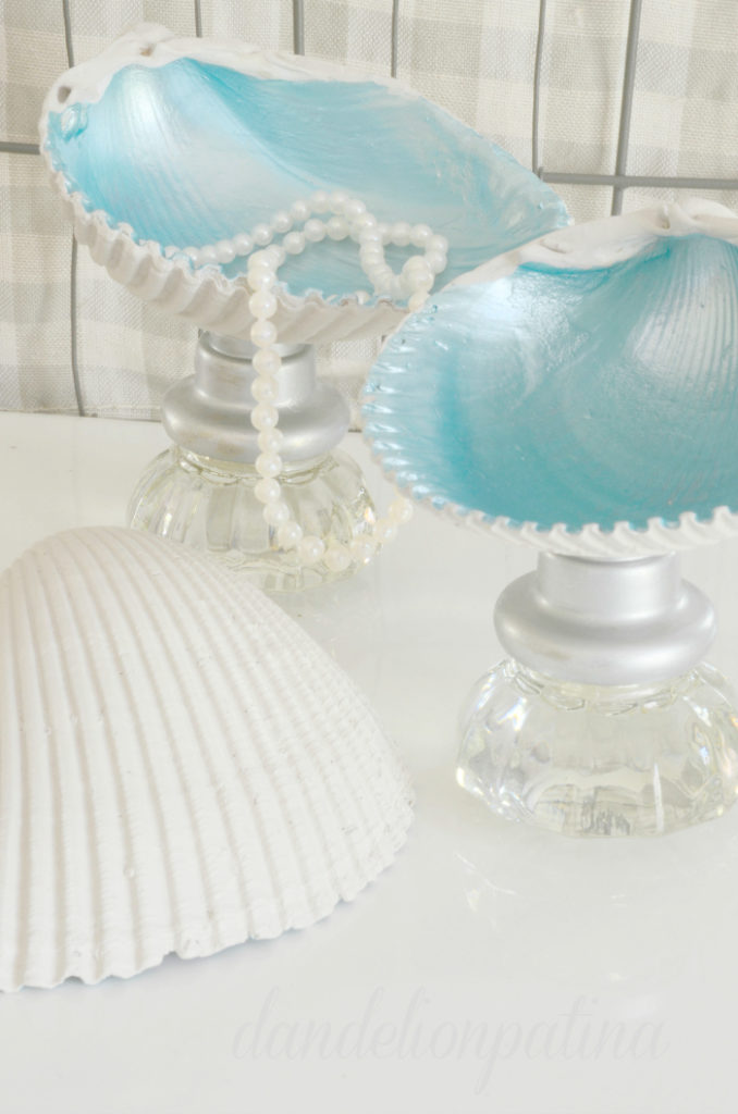 Create unique jewelry bowls from seashells and vintage glass knobs to hold your favorite baubles in by Dandelion Patina