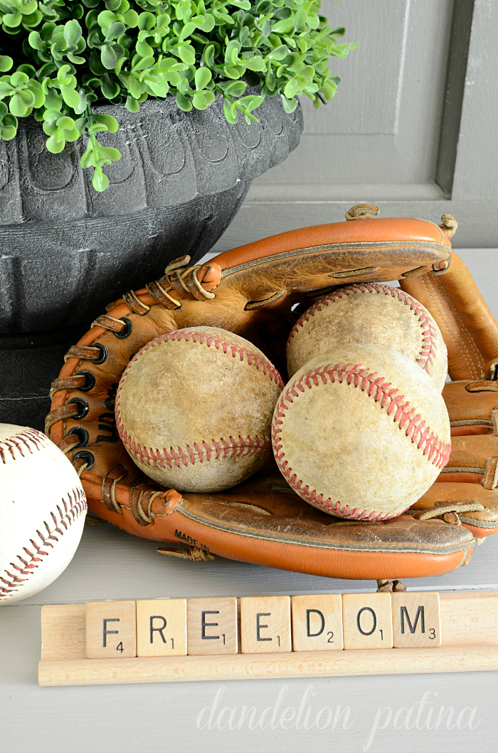 Freedom Fourth of July vignette using vintage baseballs and scrabble tiles