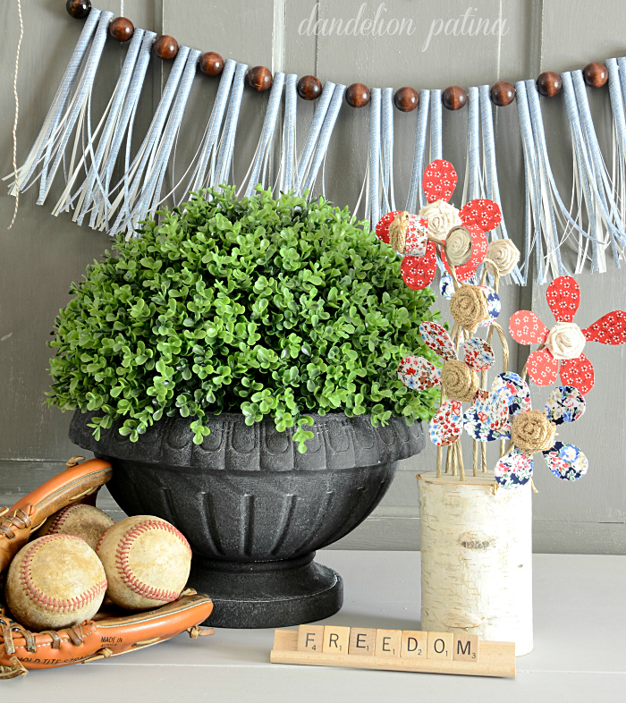 freedom and baseball caps. DIY paper straw garland with vintage baseball and DIY fabric tape flower vignette for an Americana display.
