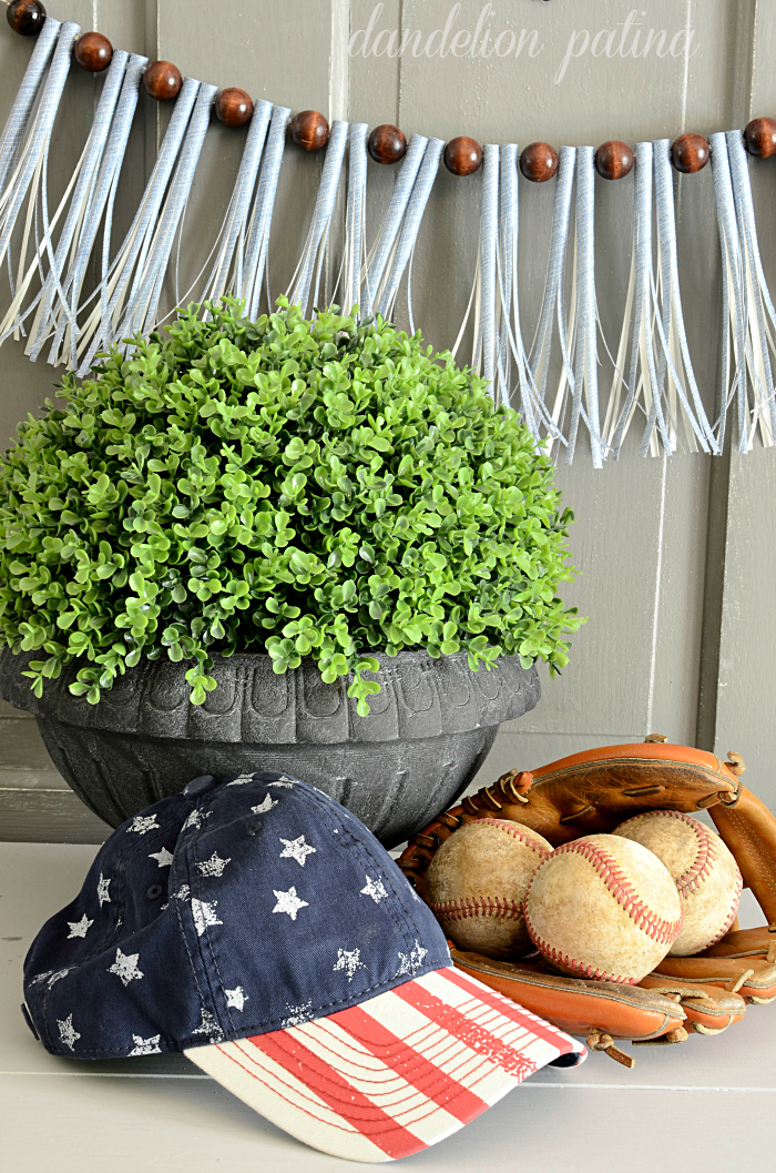freedom, baseball caps, and baseballs for a fourth of july vignette