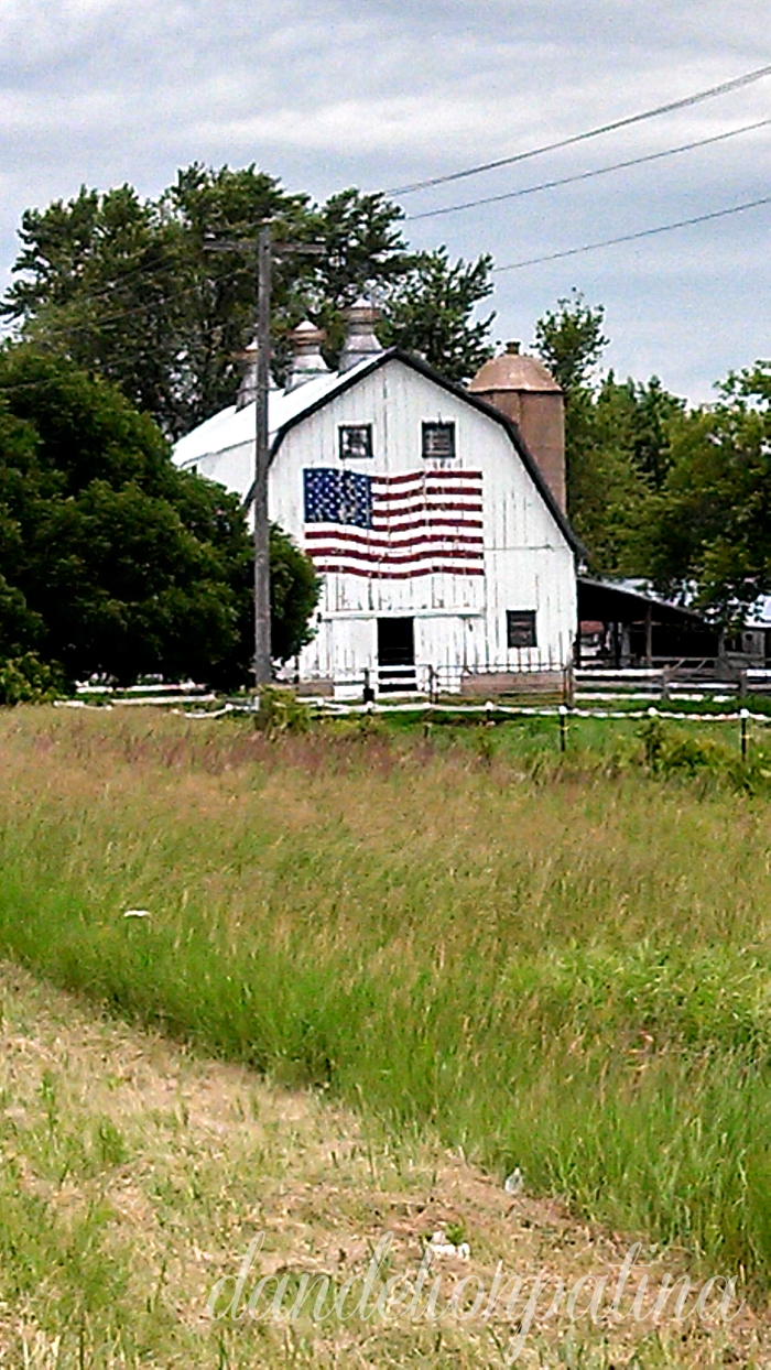white barn with american flag