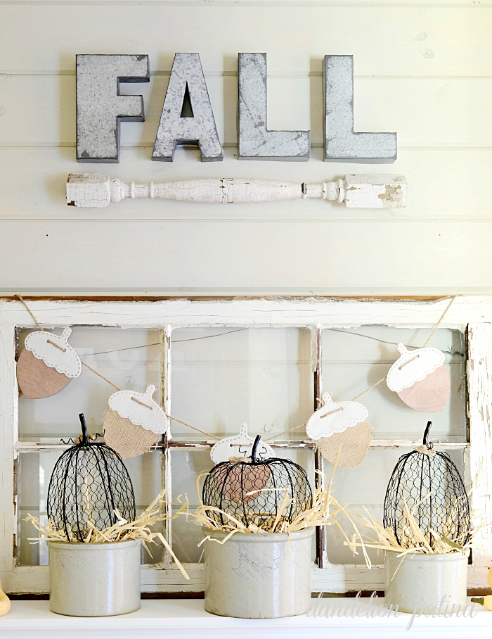 SO ADORABLE! This neutral fall mantel is the perfect blend of farmhouse and industrial style. I love neutrals with texture and wooden elements. Fall mantel styled by dandelionpatina.com #farmhousestyle #fallmantel