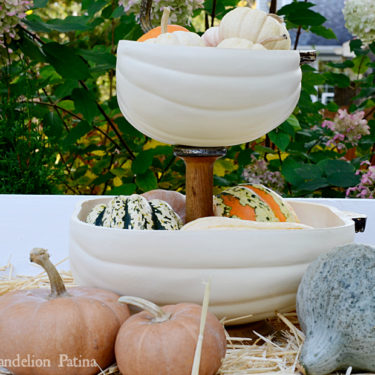 farmhouse style tiered tray with half pumpkins
