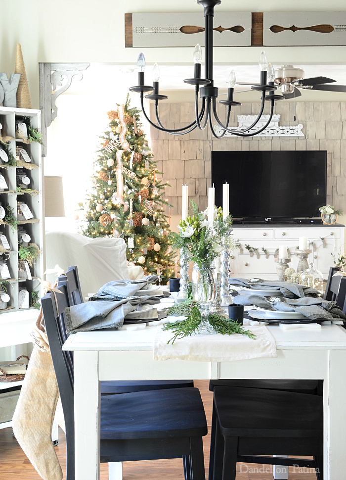 Living room dining room combination in lovely cottage style decked out for the holidays with neutral decor via dandelionpatina.com #cottagestyle
