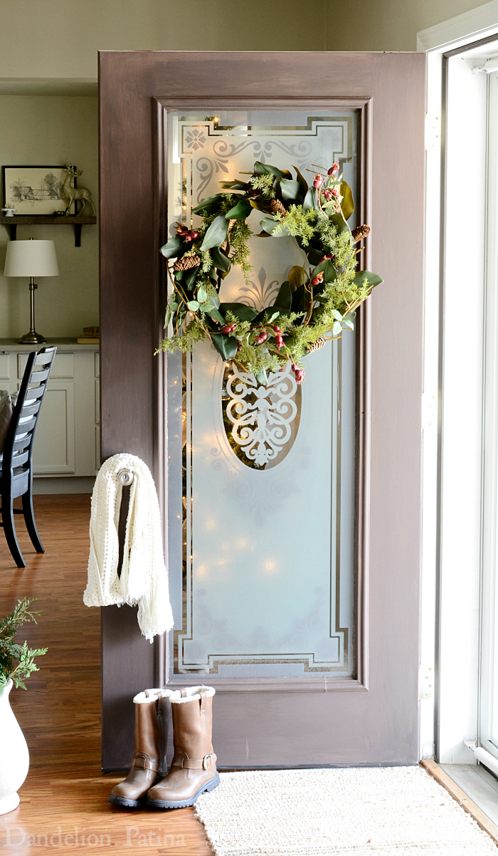 cottage style entry and foyer with faux woodgrain front door via dandelionpatina.com #cottagestyle