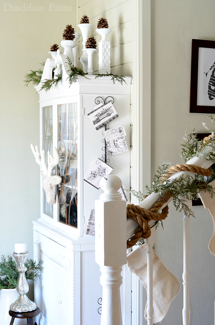 cottage style foyer with white hutch decorated for the holidays via dandelionpatina.com #cottagestyle