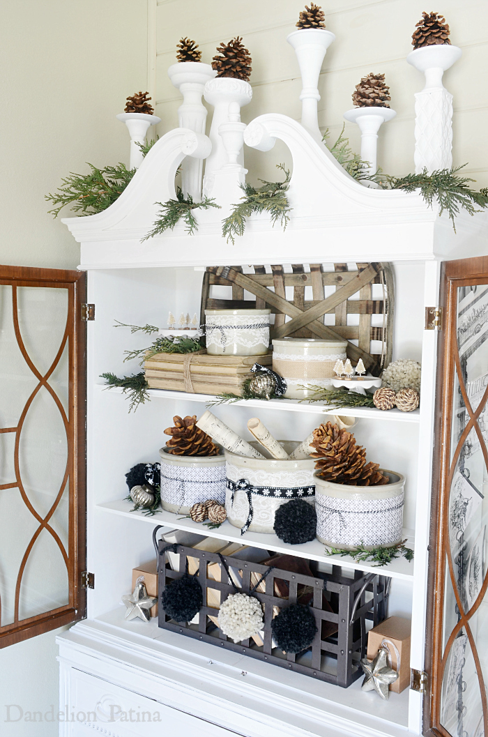 cottage style hutch vignette with vintage books, bottle brush trees and DIY pom poms via dandelionpatina.com #cottagestyle