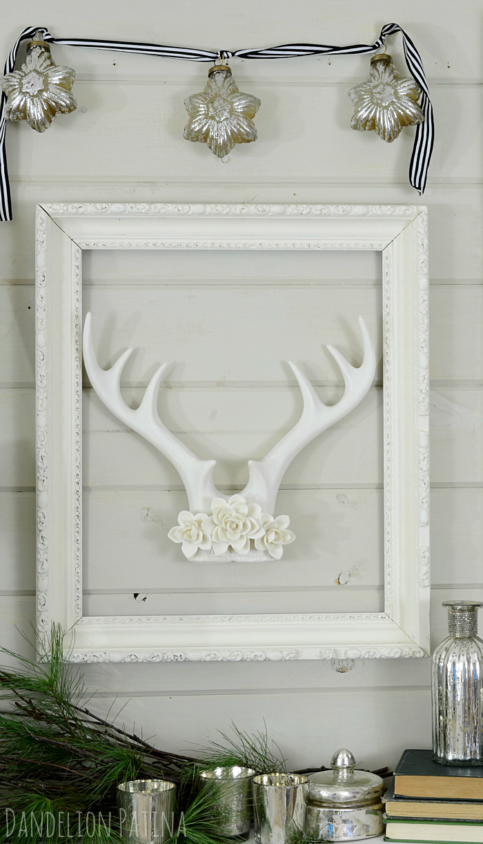 Amazing rack right? These white antlers from Target give a rustic yet feminine feel. I love how they were incorporated into a vintage frame on this cozy winter mantel via dandelionpatina.com #mantel #farmhousestyle
