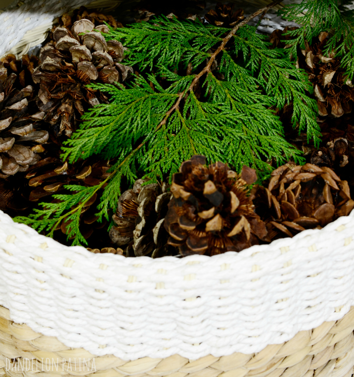 cozy winter mantel pinecones in a sisal basket and cedar greens via dandelionpatina.com #pinecones