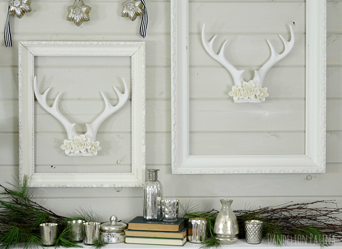 Lovely pair of white antlers paired with vintage frames, mercury glass and holiday greenery via dandelionpatina.com #cottagestyle #christmas