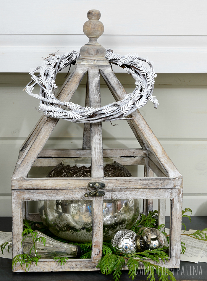 cozy winter mantel with wooden whitewashed terriarium and mercury glass via dandelionpatina.com #mantel #farmhousestyle