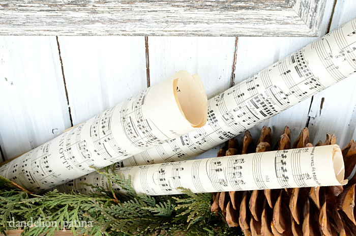 vintage sheet music and super size pine cones surround this christmas cheer chalkboard free printable via dandelionpatina.com