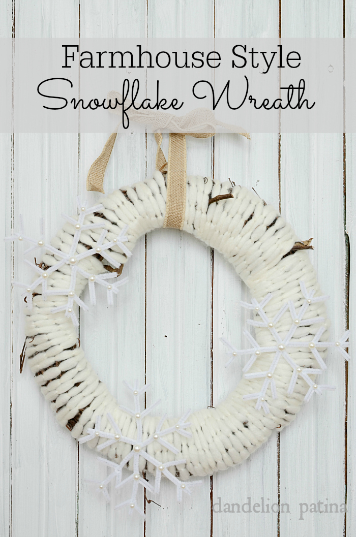Create a cozy and warm feeling right from the front door with this DIY farmhouse style snowflake wreath via dandelionpatina.com