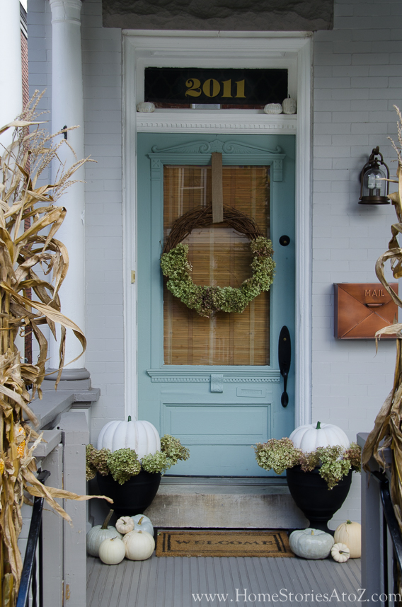 Fall Farmhouse Porch Decor Ideas With White Pumpkins And Dried Hydrangeas